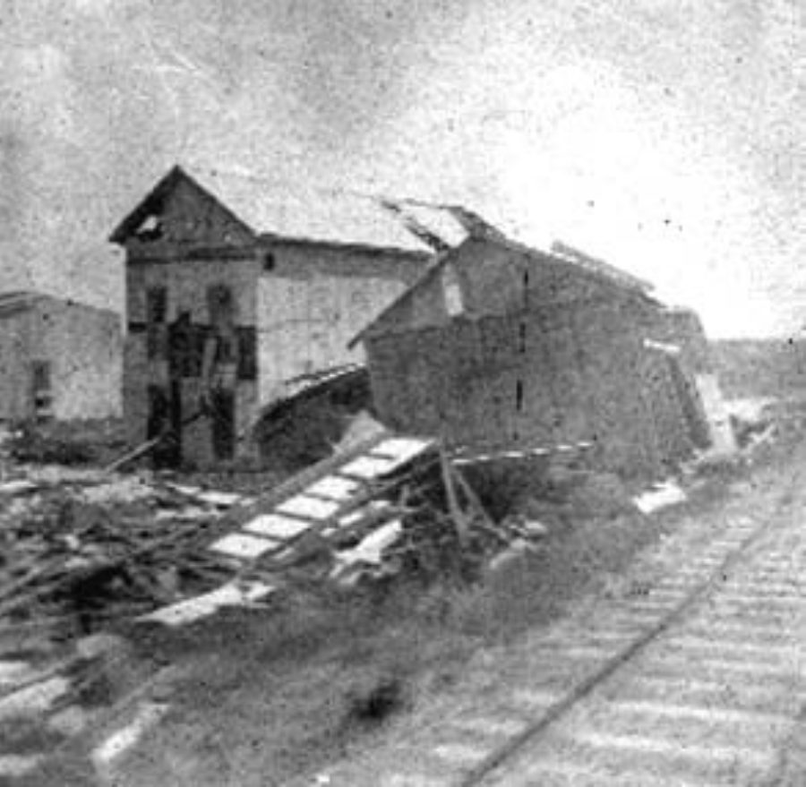 G-1771FF7.10-11 Two wrecked houses alongside railroad track