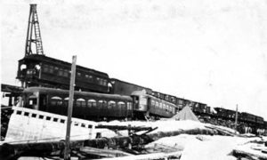 G-17713FF3.2-6 Derailed passenger cars on wrecked causeway