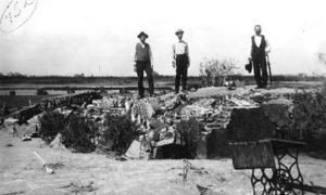 G-1771FF7.2-6 Three men standing on ruins of brick foundation