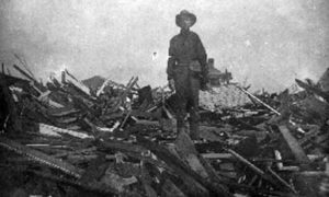G-1771FF7.6-3 Soldier standing on debris
