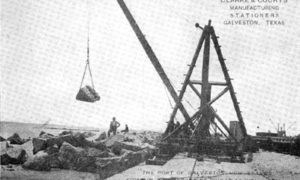 "G-5925.1FF3-4 THE GALVESTON SEAWALL.""  ""DERRICK LAYING RIPRAP.  A 1500 LB. ROCK IN MIDAIR."