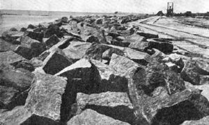 G-5925.1FF3-6 THE GALVESTON SEAWALL.  SCENE SHOWING RIPRAP AND FOUNDATION OF SEAWALL.