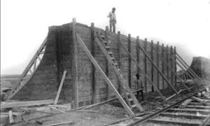 G-5925.2FF1-2 Worker standing atop section of Seawall under construction