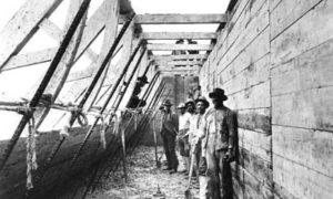 G-5925.2FF2-7 Workmen standing inside wood caisson