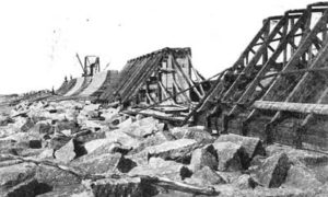 G-5925.2FF3-3 THE GALVESTON SEAWALL.  Showing the first few sections built to break the waves and frame work required to shape same.