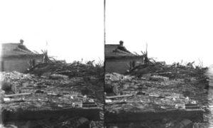 SC#194-31 Pile of debris surrounding damaged house.