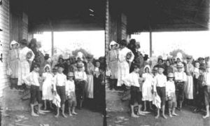 SC#194-38 Women and children waiting outside store for issuance of relief supplies.