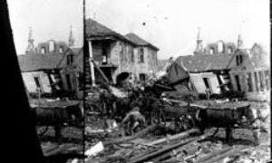 SC#194-52 Workmen placing debris in wagons in residential area.
