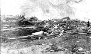 SC#204-2 Wreckage and debris near beach with body of a woman in front