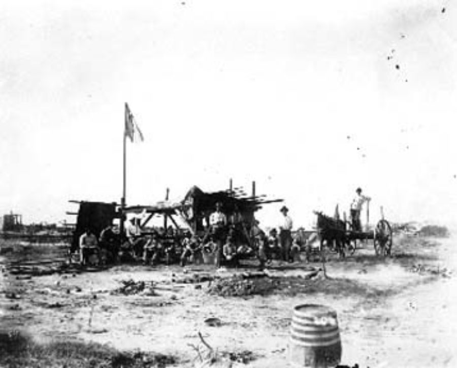G-1771FF10.1-1 Group of workers with wagon at camp site