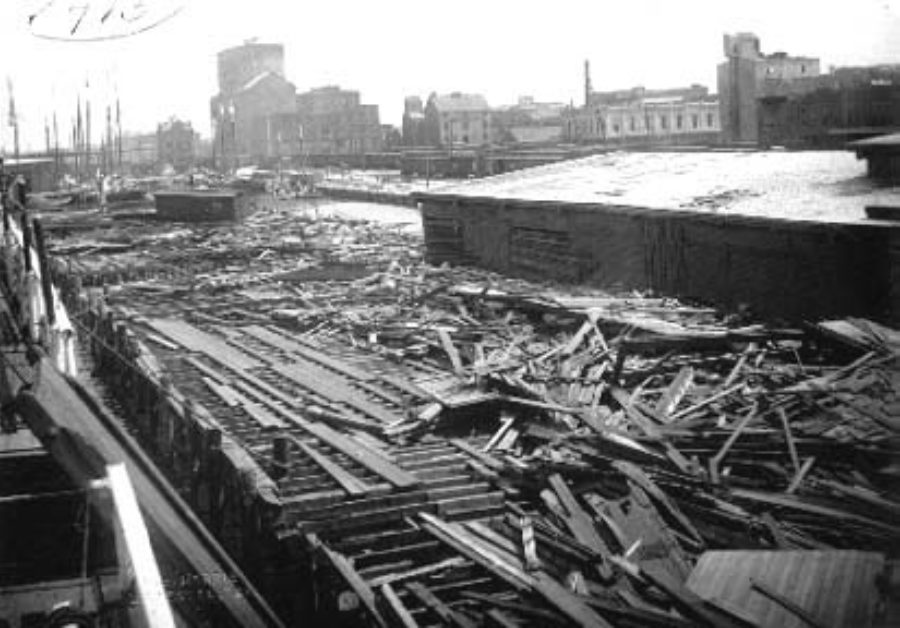 G-1771FF2.2-4 Debris and freight car strewn along wharf