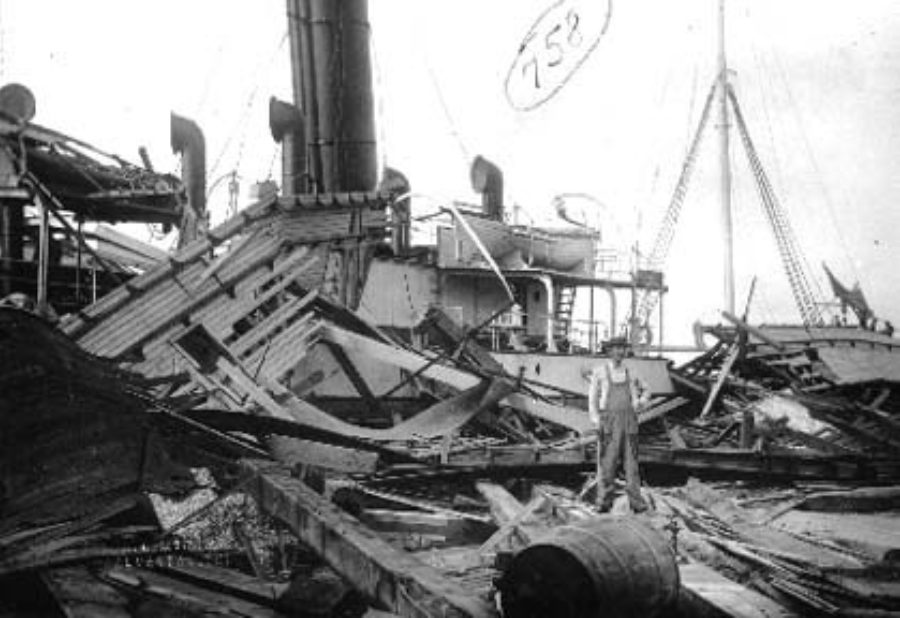 G-1771FF2.2-8 Man standing on board wrecked steamship