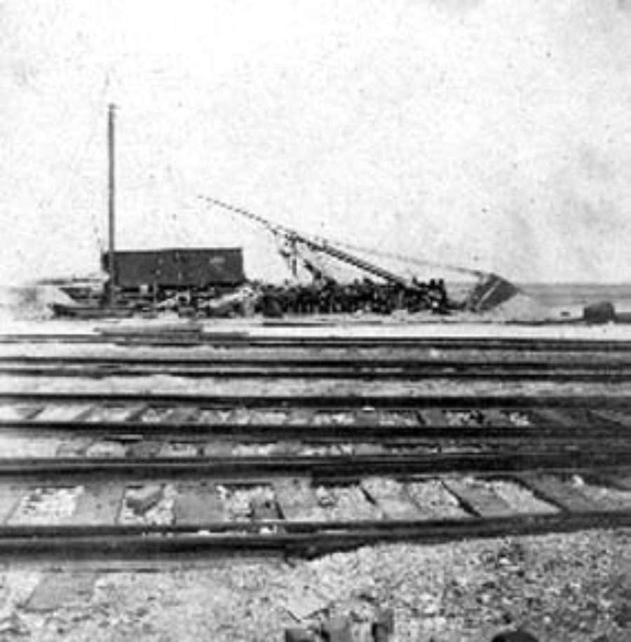 G-1771FF2.3-10 Railroad tracks and wrecked freight car and sailing vessel