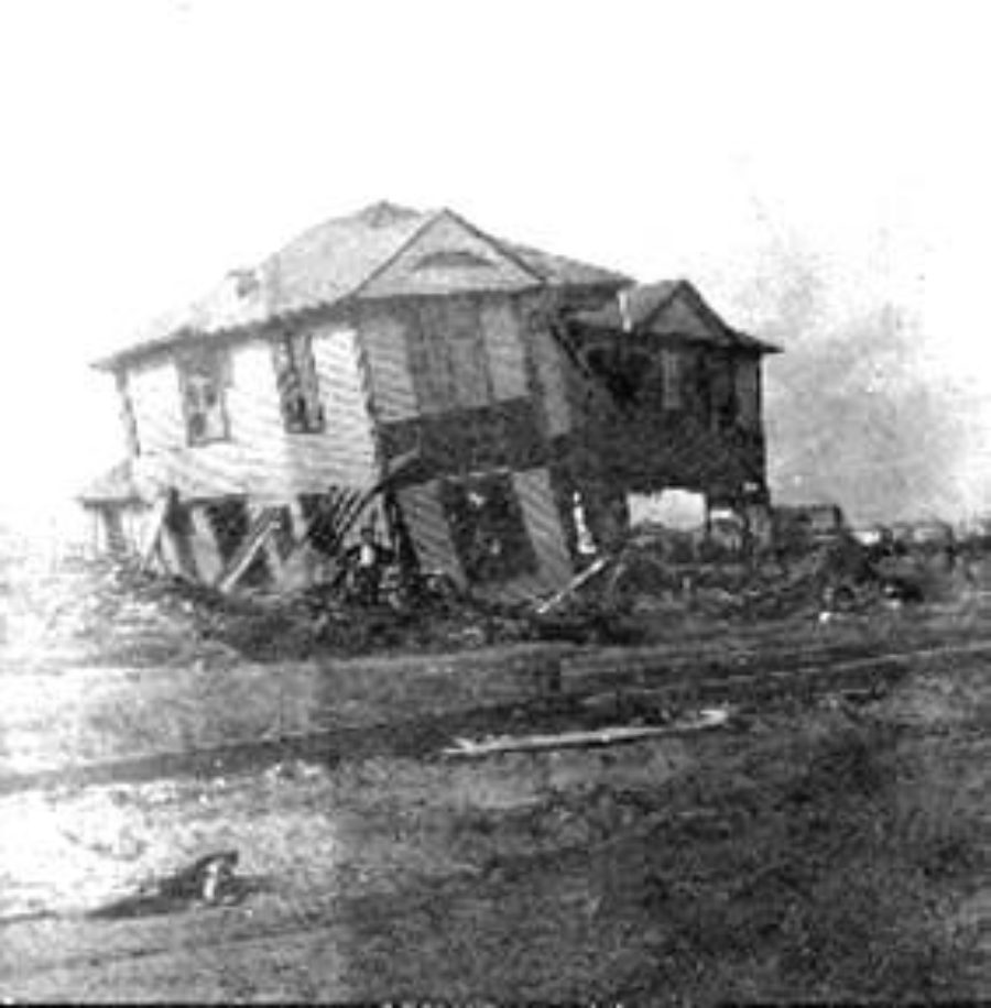G-1771FF7.10-10 Two wrecked houses along street