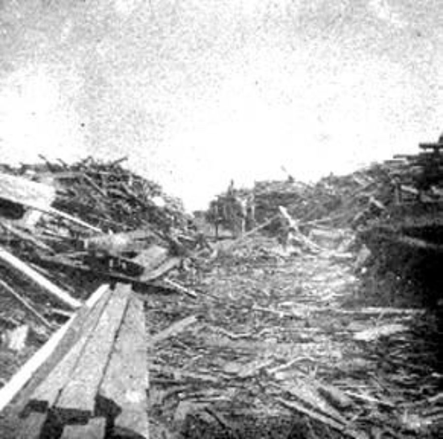 G-1771FF7.13-5 Workers standing in cut through debris