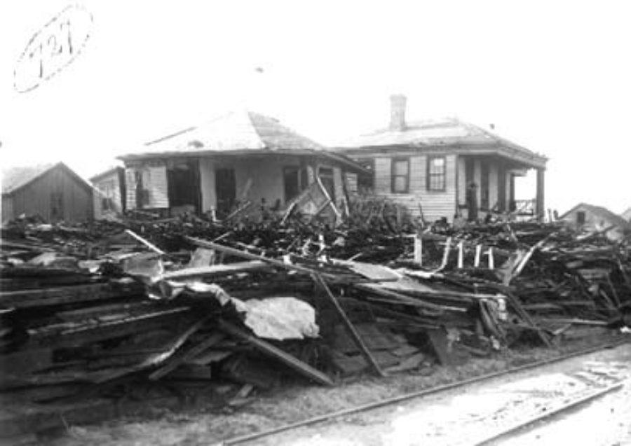 G-1771FF7.2-4 Debris piled up along street