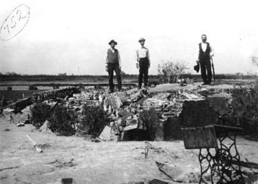 G-1771FF7.2-6 Three men standing on ruins of brick foundation