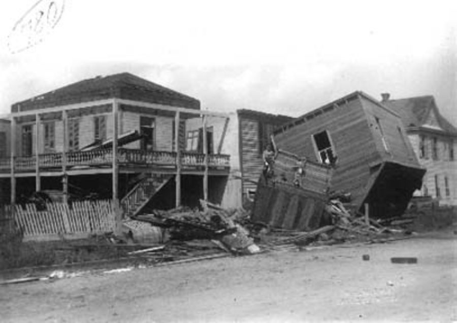 G-1771FF7.3-3 Wrecked houses along street