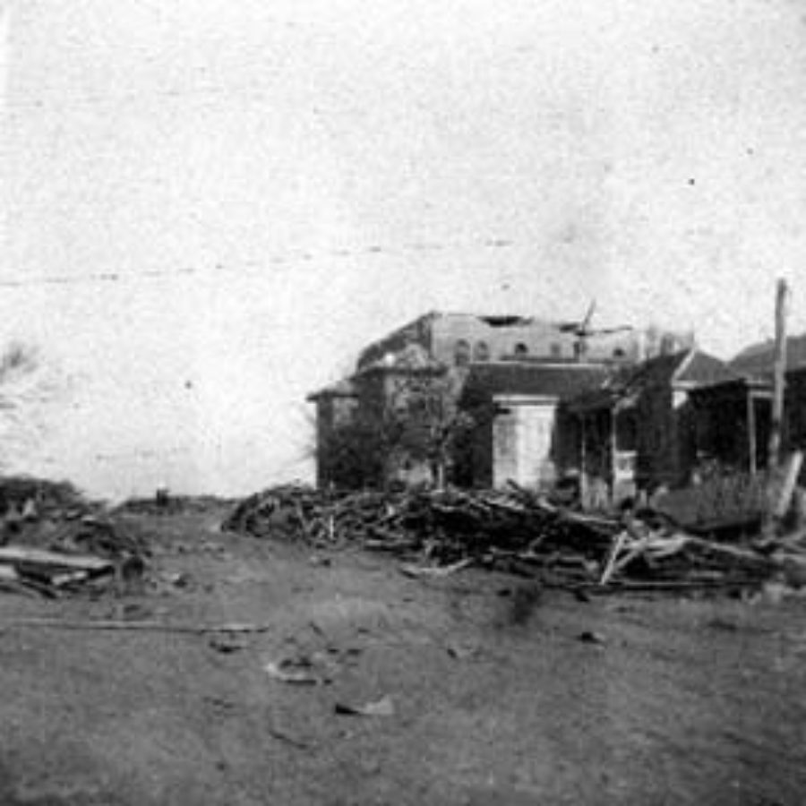 G-1771FF7.5-5 Clearing and debris( foreground), and house (right background)