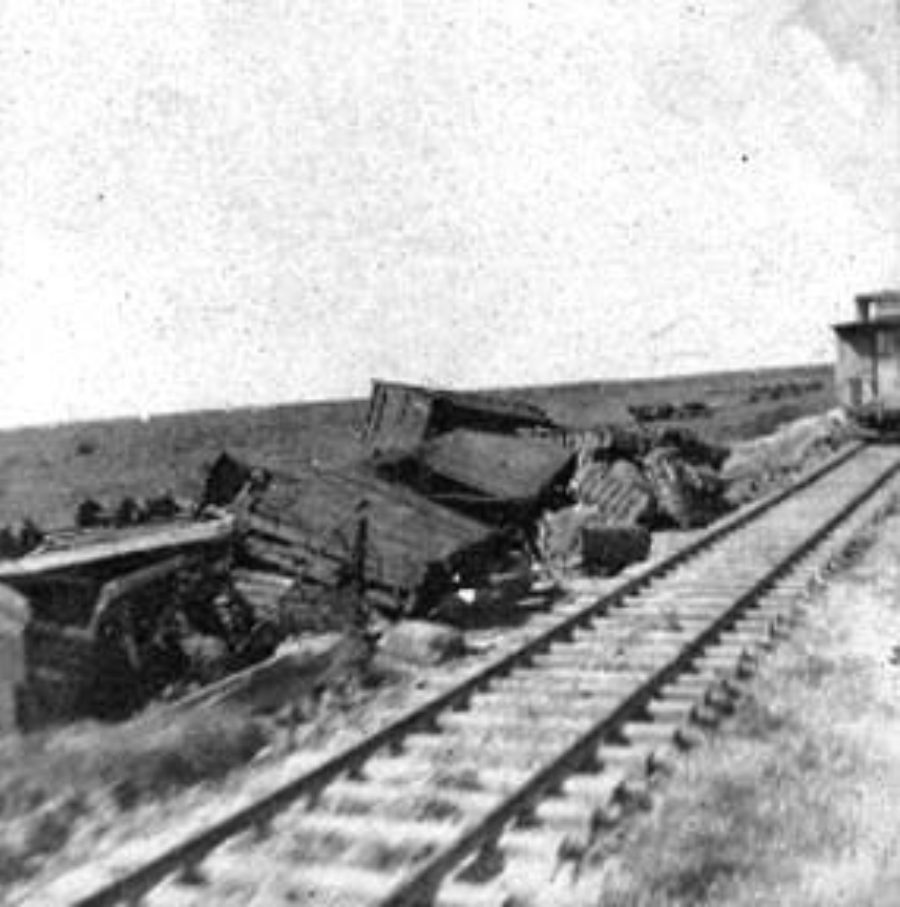 G-1771FF9.1-1 Overturned freight cars next to railroad track
