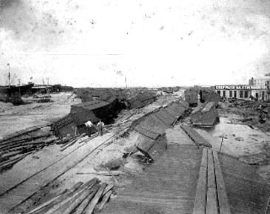 G-1771FF9.1-12 Wrecked and overturned freight cars in freight yard