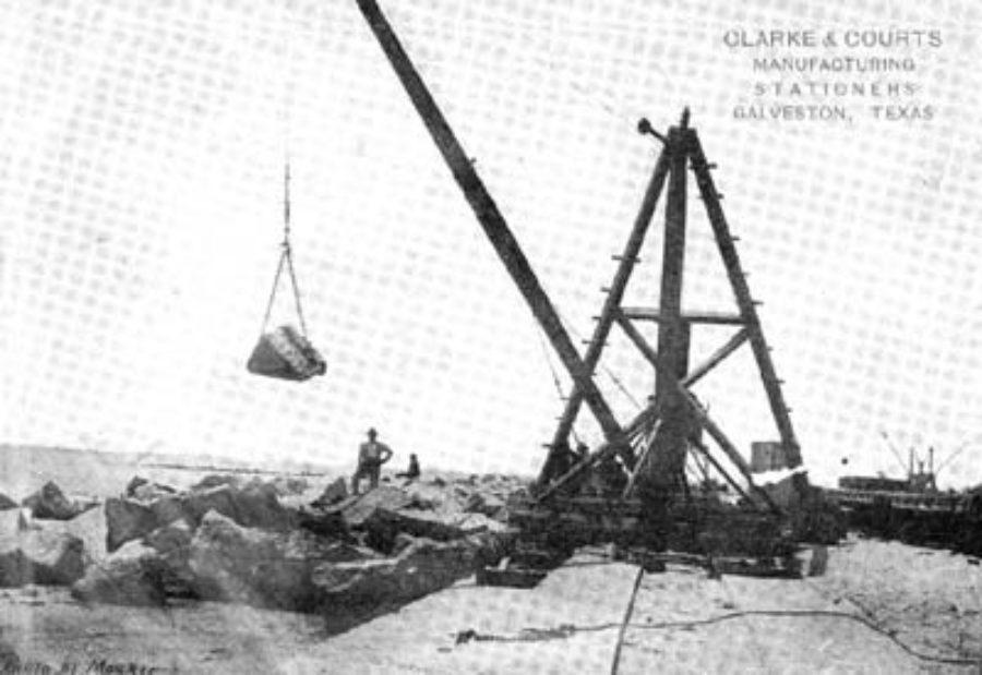 G-5925.1FF3-10 THE GALVESTON SEAWALL.  DERRICK LAYING RIPRAP.  A 1500 LB. ROCK IN MIDAIR.