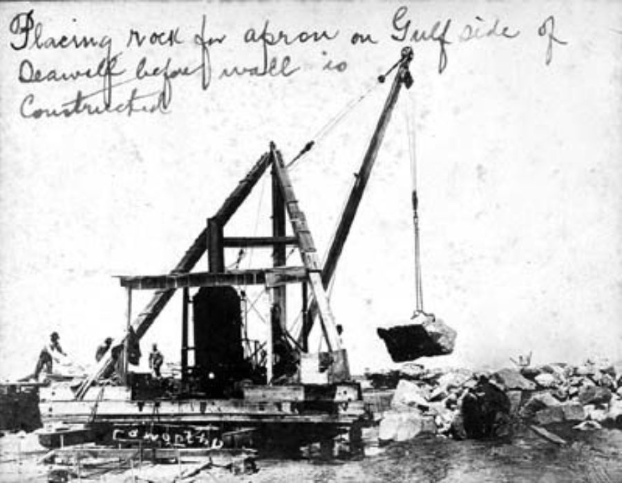 G-5925.1FF3-11 Placing rock for apron on Gulf side of Seawall before wall is constructed