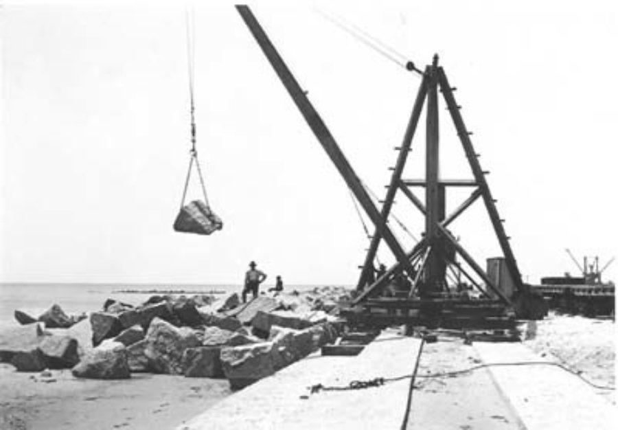 G-5925.1FF3-13 Derrick laying riprap along foundation of Seawall