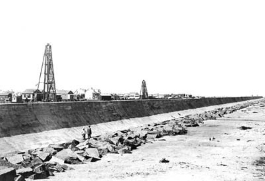 G-5925.3FF6-6 Two men standing on riprap at base of Seawall