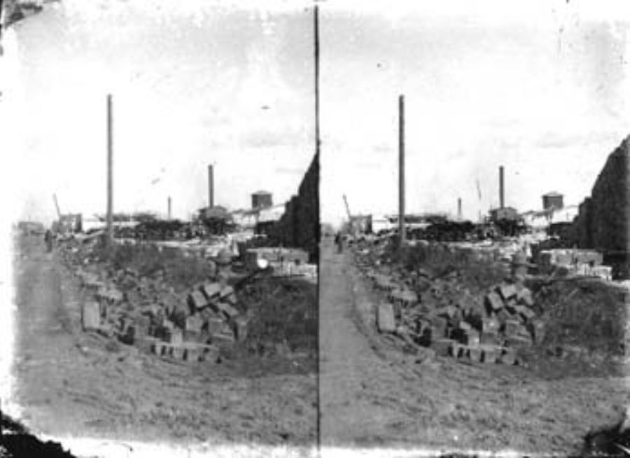 SC#194-21 Debris (foreground), and wrecked buildings (background).