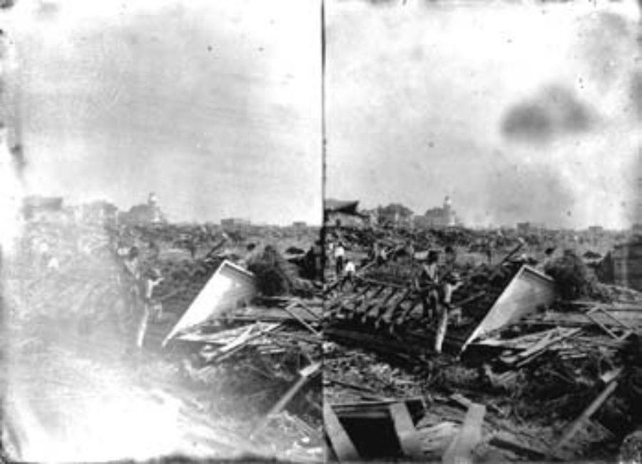 SC#194-26 Workmen clearing away debris.