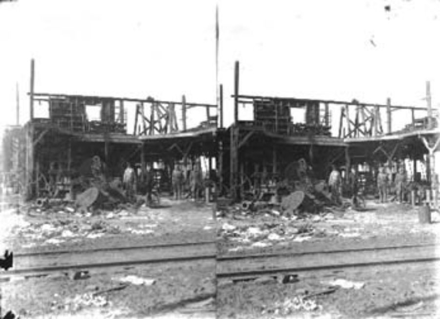 SC#194-32 Street railway track (foreground) and gutted building (background).