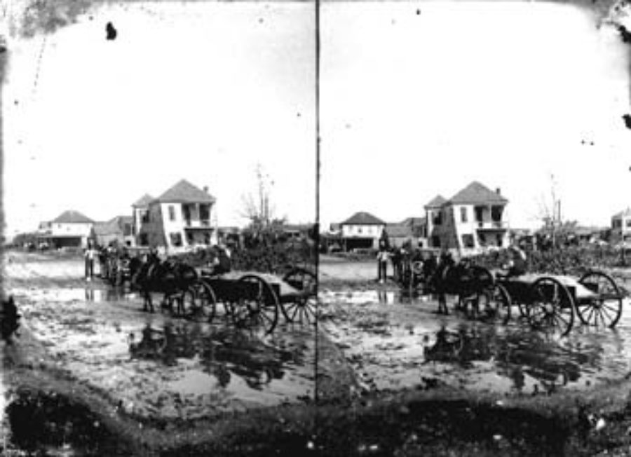 SC#194-50 Wagons passing through flooded residential area.