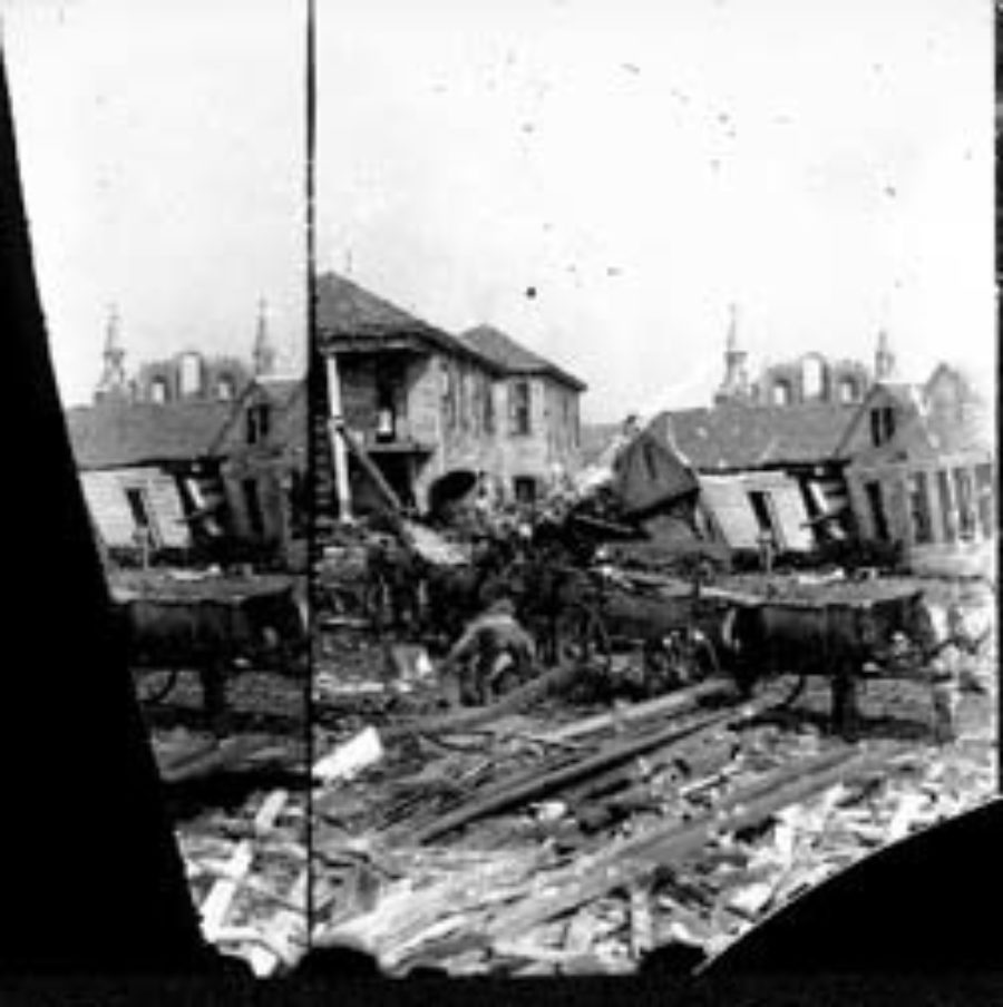 SC#194-52 Workmen placing debris in wagons in residential area.