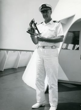 Captain David B. McMichael using a sextant while aboard Savannah, 1964 Savannah's Voyage from Galveston to Europe, Back to Galveston